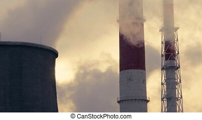 Smoking pipes of power plant on sky background