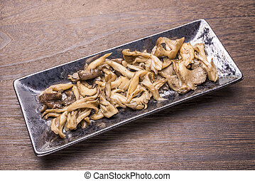 Sauteed mushrooms(Hen of the woods) on a oblong pottery...