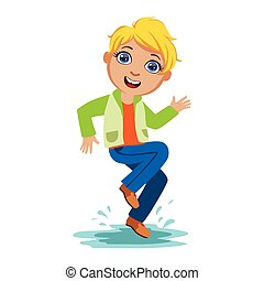 Boy Dancing Splashing Water, Kid In Autumn Clothes In Fall Season Enjoyingn Rain And Rainy Weather, Splashes And Puddles