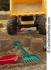 Sandpit with toys - strewed tools