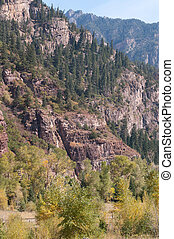 Near Ouray, Colorado - Peaks and red cliffs tower over the...