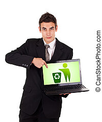 Business man pointing at a laptop with recycle icon isolated...