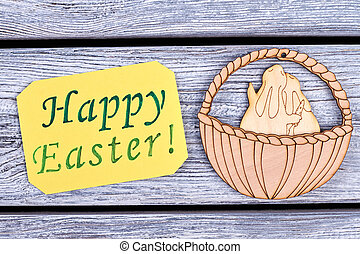 Happy Easter card. Plywood rabbits in a basket. Easter...