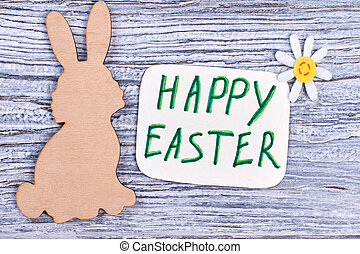 Easter holiday card. - Wooden Easter rabbit. Easter holiday...
