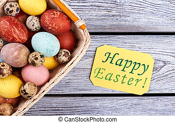 Happy Easter card and basket. Quail and chicken eggs.