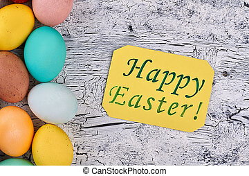 Happy Easter card, painted eggs. Greeting card, white wood...