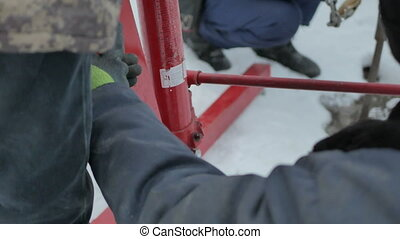 Workers work with a hydraulic hoist - Workers work with a...