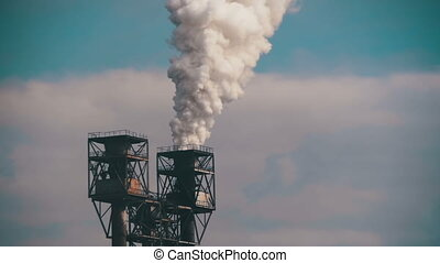 Smoke from Pipes of the Industrial Plant in the City. Slow Motion