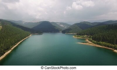 Aerial view over lake and mountains - Aerial view of the...