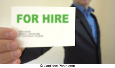 Job Seeker Holding For Hire Card - Shot of Job Seeker...