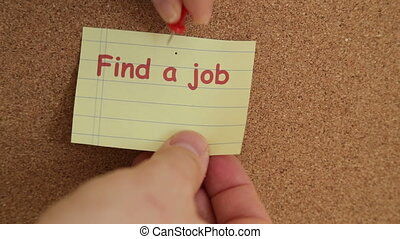 Job searching reminder note attached to a bulletin board made of cork