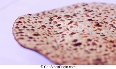 Jewish passover holiday Matzo (Jewish bread) background -...
