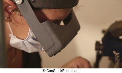 Jewelry maker with face protection - Shot of Jewelry maker...
