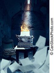 Old typewriter with burning sheet of paper - Old typewriter...