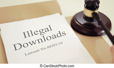 illegal downloads lawsuit documents with gavel placed on desk of judge in court