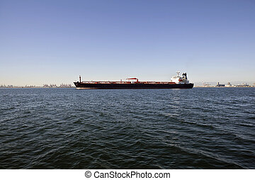 Oil Tanker - Large oil tanker anchored in a wide industrial...