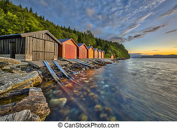 Colorful Boathouse in Norwegian fjord near Rodven in More og...