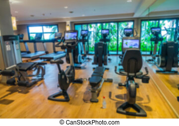 Abstract blur Fitness center with traineger equipments . -...