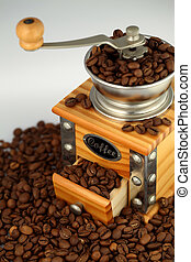 coffee grinder - an old-fashioned wooden coffee grinder
