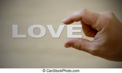 Holding the word love - Shot of Holding the word love