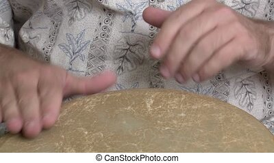 drum beat on a djembe - hands create a drum beat on a djembe