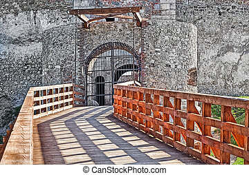 Wooden bridge and old stone castle