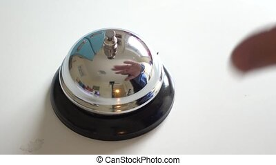 Hand ring service call bell on white