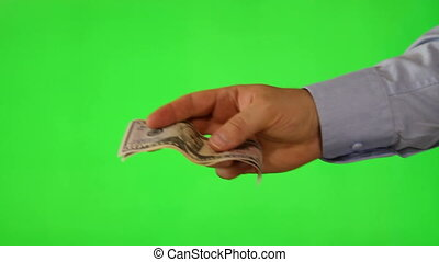 Hand offering money on green screen - Shot of Hand offering...