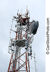 Communication antenna tower with sky background