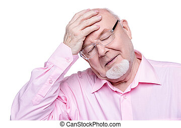 high blood pressure - The old man keeps a hand on his head....