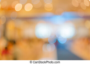 Abstract blur of wedding party in large hall .