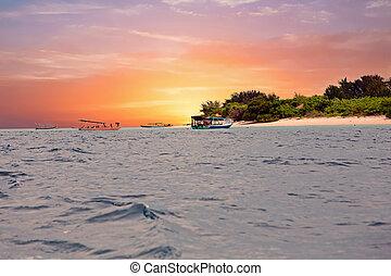 Traditional boats at Gili Meno island beach, Indonesia at...
