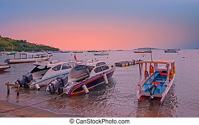 Boats on the beach at Gili Trawangan in Indonesia at sunset