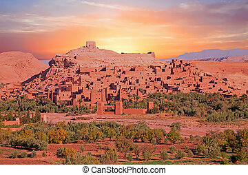 The fortified town of Ait ben Haddou at sunset near...