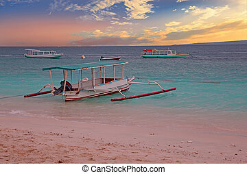 Traditional boat on Gili Meno island beach, Indonesia at...