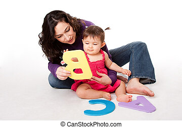Baby learning alphabet ABC - Mother, nanny, or teacher...