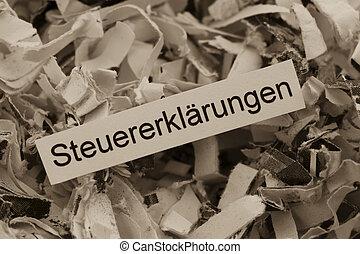 shredded paper tax returns - papierschnitzel tagged with tax...