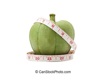 Garcinia Cambogia with measuring tape isolated on white...