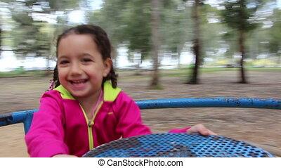 girl on carousel - Shot of girl on carousel