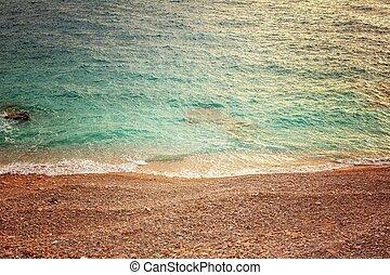 Sea and polished rocks closeup