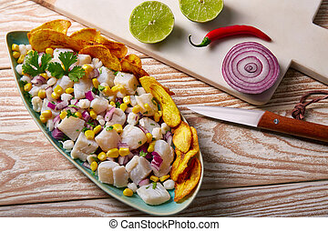 Ceviche peruvian recipe with fried banana and ingredients on...
