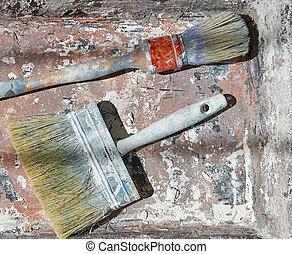 Paint brushes used on grunge bucket