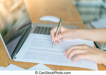 Business woman hand with Financial charts and laptop on the...