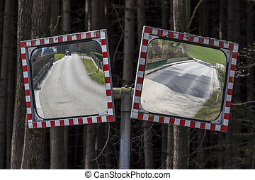 traffic mirror - two traffic mirrors are at the junction of...