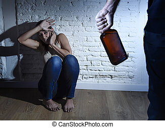 alcoholic drunk man attacking woman or wife with bottle in...