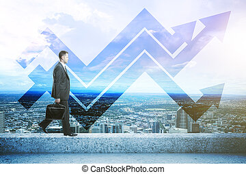 Success concept - Side view of businessman walking on the...