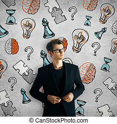 Achievement concept - Thoughtful young businessman on...