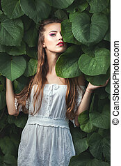 Woman with green eyes among nature. - Young woman with green...