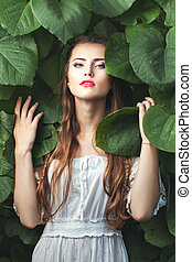 Gentle woman among nature. - Portrait of a beautiful and...