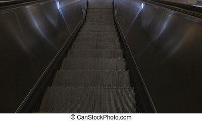 Moving the steps to the escalator down. An empty shopping...